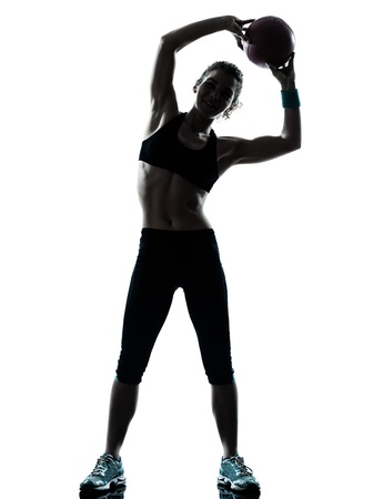 a l ecart: one caucasian woman exercising fitness ball workout posture in silhouette studio isolated on white background