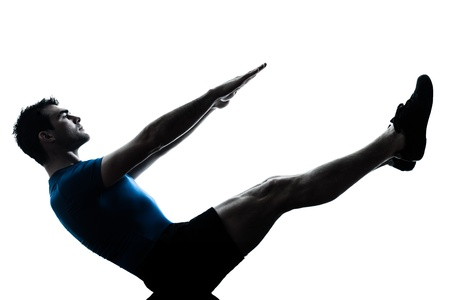 ombres: one caucasian man exercising workout fitness boat position yoga in silhouette studio  isolated on white background
