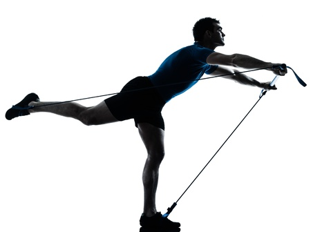 a l ecart: one caucasian man exercising gymstick workout fitness in silhouette studio  isolated on white background