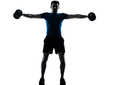 regards objectifs: one caucasian man exercising weight training workout fitness in silhouette studio  isolated on white background