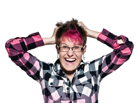 Portrait of an angry woman pulling her hair in frustration in studio on white isolated background photo