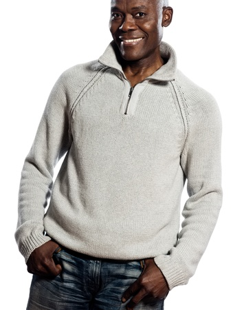 Casual mature afro American man standing smiling in studio with hands in pocket on isolated white background photo