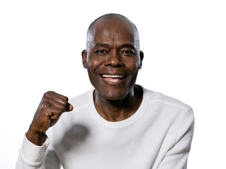 regards objectifs: Close-up portrait of an excited afro American man clenching fist in studio on white isolated background