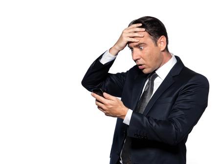 fonds blanc: handsome caucasian man looking at phone astonish portrait isolated studio on white background Stock Photo