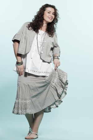 regards objectifs: large build caucasian woman full length spring summer fashion models clothes clothings on studio isolated plain background