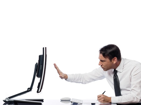 relationship between a caucasian man and a computer display monitor on isolated white background expressing intrusion rejection concept Stock Photo