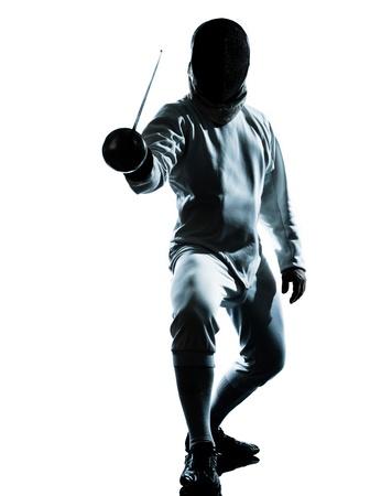 hommes: una silueta de hombre de esgrima en el estudio aislado sobre fondo blanco Foto de archivo