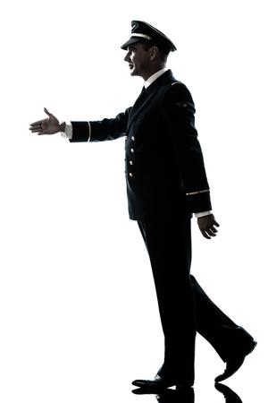 one caucasian man in airline pilot uniform walking handshake silhouette in studio isolated on white background Stock Photo - 14354778