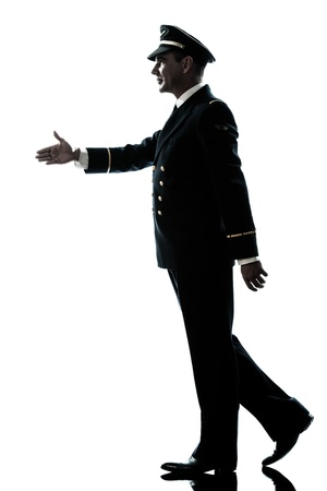 a l ecart: one caucasian man in airline pilot uniform walking handshake silhouette in studio isolated on white background