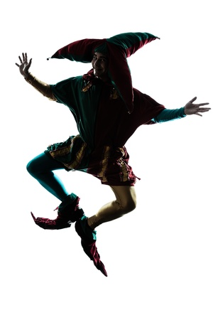 ombres: one caucasian man in jester costume jumping silhouette in studio isolated on white background