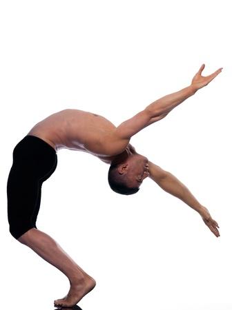 caucasian man stretch gymnastic equilibrium isolated studio on white background