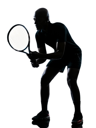 ombres: man african afro american playing tennis player on studio isolated on white background