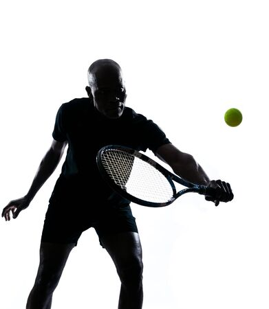 a l ecart: man african afro american playing tennis player backhand, on studio isolated on white background