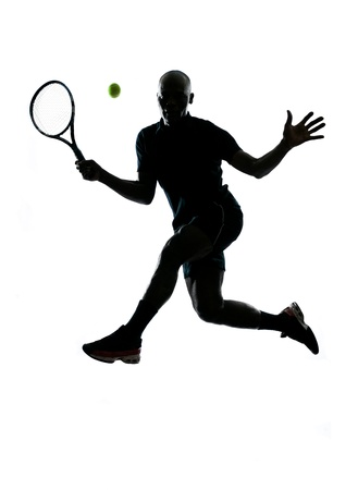 a l ecart: man african afro american playing tennis player forehand on studio isolated on white background Stock Photo