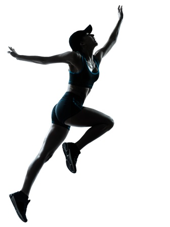 isolees: one caucasian woman runner jogger jumping in silhouette studio isolated on white background