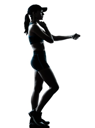 a l ecart: one caucasian woman runner jogger in silhouette studio isolated on white background
