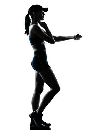 personas trotando: una mujer de raza cauc�sica corredor corredor en el estudio de la silueta sobre fondo blanco