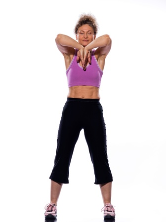 detourables: beautiful mature woman on isolated white background doing stretching exercise