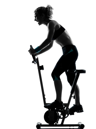 ombres: one woman biking exercising workout fitness aerobic exercise posture on studio isolated white background