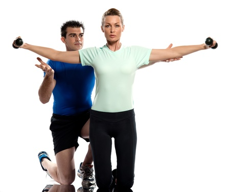 fonds blanc: one caucasian couple man aerobic trainer positioning woman  Workout coach Posture in indoors studio isolated on white background Stock Photo