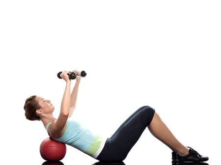 pectoral: woman exercising abdominal workout on white background with weights