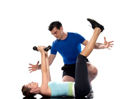 detourables: one caucasian couple man aerobic trainer positioning woman  Workout coach Posture in indoors studio isolated on white background Stock Photo