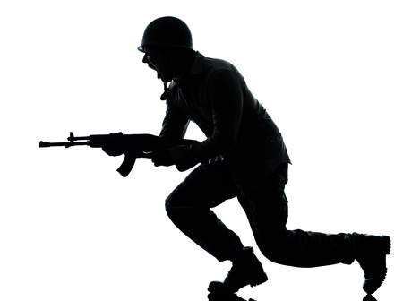 one caucasian army soldier man attacking on studio isolated on white background photo
