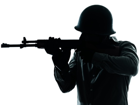 army men: one caucasian army soldier man shooting on studio isolated on white background