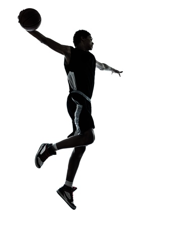 basketball shot: one young man basketball player silhouette in studio isolated on white background Stock Photo