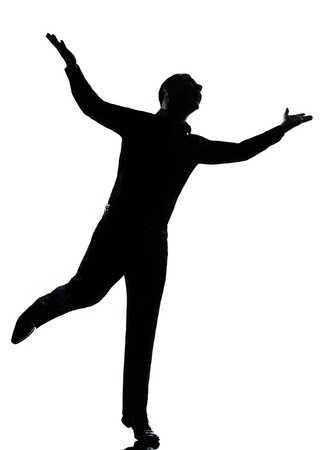 one caucasian business man  happy spreading arms silhouette Full length in studio isolated on white background photo