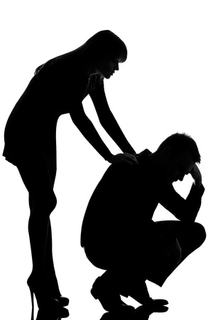 one caucasian couple man sad  and woman caring consoling in studio silhouette isolated on white background photo