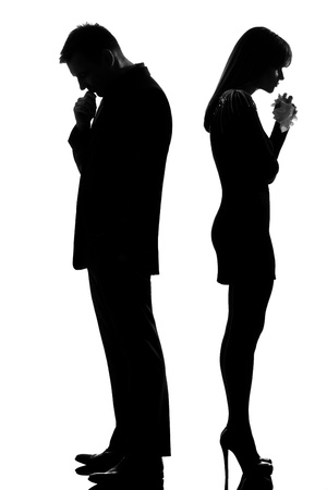 difficulties: one caucasian sad couple back to back man thinking and woman crying standing back to back man and woman in studio silhouette isolated on white background