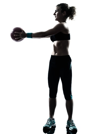 one caucasian woman exercising fitness ball workout posture in silhouette studio isolated on white background photo