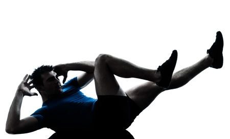 lying on the stomach: one caucasian man exercising workout fitness in silhouette studio  isolated on white background