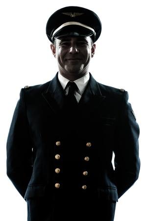 un hombre caucásico con uniforme de piloto de avión en el estudio aislado sobre fondo blanco Foto de archivo
