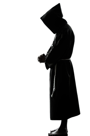 one caucasian man priest praying silhouette in studio isolated on white background Stock Photo - 14649870