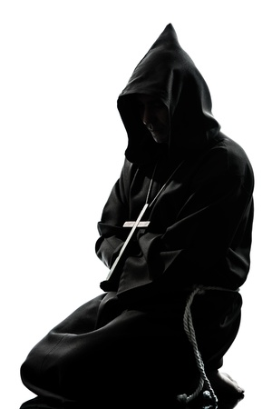 kneel down: one caucasian man priest praying silhouette in studio isolated on white background Stock Photo