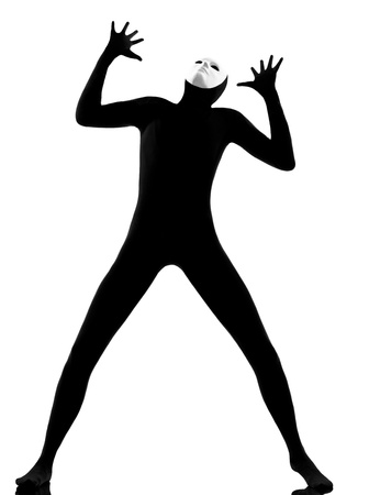 performer man mime with mask complaigning looking up on studio isolated on white background Stock Photo