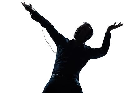 bailarin hombre: un hombre feliz cauc�sico escuchar a la silueta de la m�sica retrato en el estudio de fondo blanco aisladas Foto de archivo