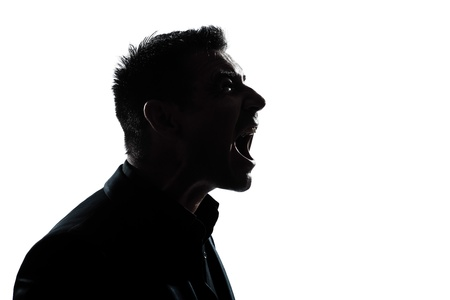 one caucasian man portrait silhouette profile screaming angry in studio isolated white background photo