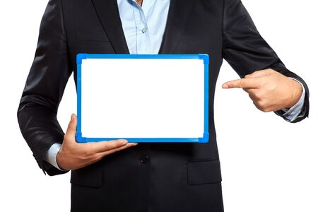 hands out: one caucasian business man holding showing whiteboard in studio isolated on white background