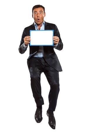 one caucasian surprised business man  jumping holding showing whiteboard in studio isolated on white background photo