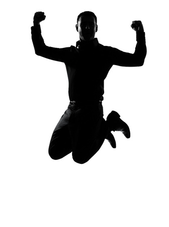 one caucasian business man jumping powerful  silhouette Full length in studio isolated on white background photo