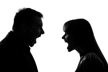 man scolding: one caucasian couple man and woman face to face screaming shouting dipute in studio silhouette isolated on white background Stock Photo