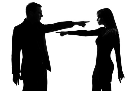 quarrel: one caucasian couple man and woman pointing at each other expressing accusation in studio silhouette isolated on white background