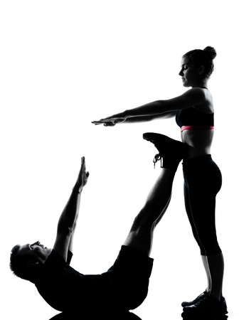 one couple man woman exercising workout aerobic fitness posture full length silhouette on studio isolated on white background Stock Photo - 14683198