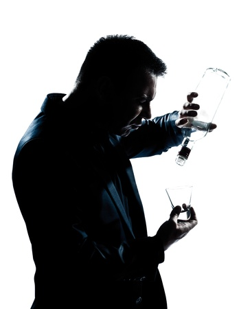 drunk: one caucasian man portrait silhouette drunk puring empty alcohol botlle in studio isolated white background