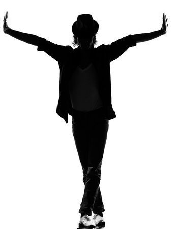 full length silhouette of a young man dancer dancing funky hip hop r&b on  isolated  studio white background Stock Photo - 14683163