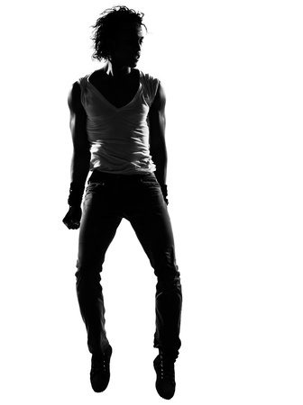 full length silhouette of a young man dancer dancing funky hip hop r&b on  isolated  studio white background Stock Photo - 14683185