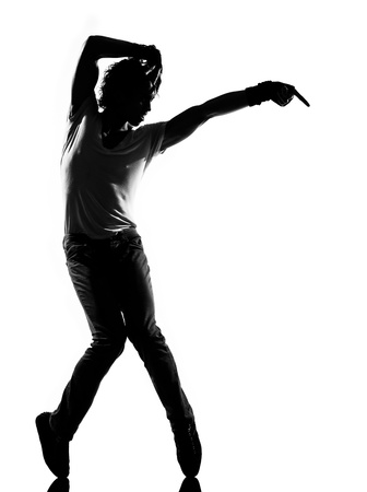 hip hop silhouette: full length silhouette of a young man dancer dancing funky hip hop r&b on  isolated  studio white background